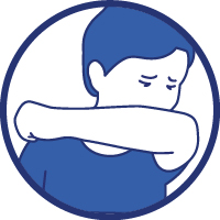 Une personne tousse dans son coude