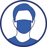 Une personne porte un masque
