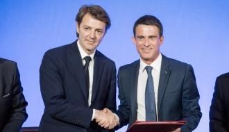 Signature de la  une convention de partenariat entre l'État et l'Association des maires de France relative à la prévention de la radicalisation violente