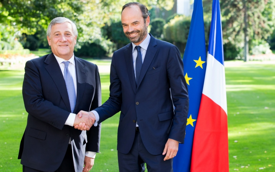 Edouard Philippe and Antonio Tajani shake hands in Matignon's garden