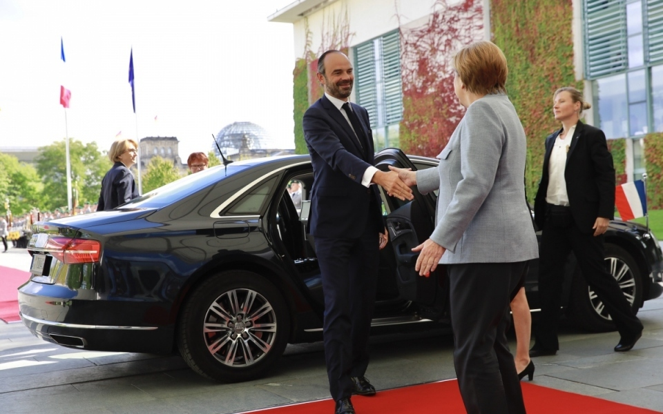 Édouard Philippe shaking hands with Chancellor Angela Merkel