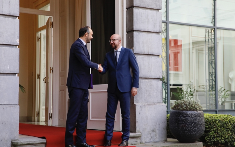 The Prime Minister is welcomed by his Belgian counterpart, Charles Michel