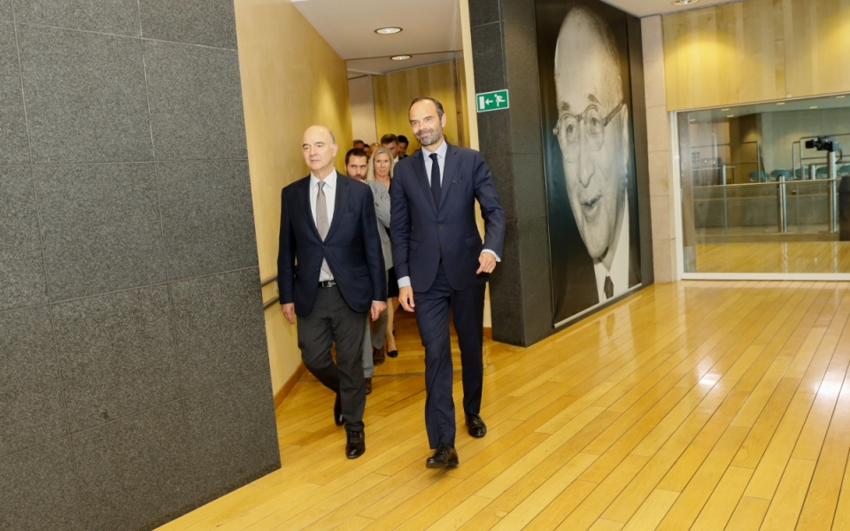 The Prime Minister next to European Commissioner Pierre Moscovici