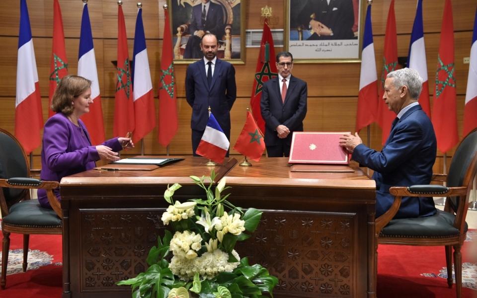 Cérémonie de signatures d'accords à l'issue de la séance plénière de la réunion de haut niveau.