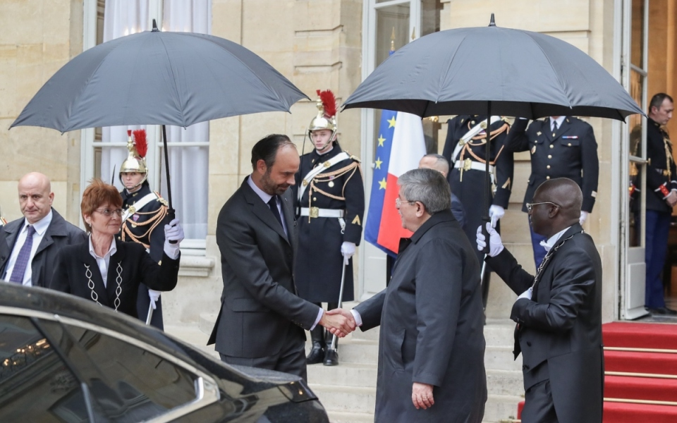The Algerian Prime Minister, Ahmed Ouyahia, departs.