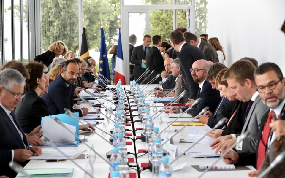 Édouard Philippe and Charles Michel in a meeting with their teams