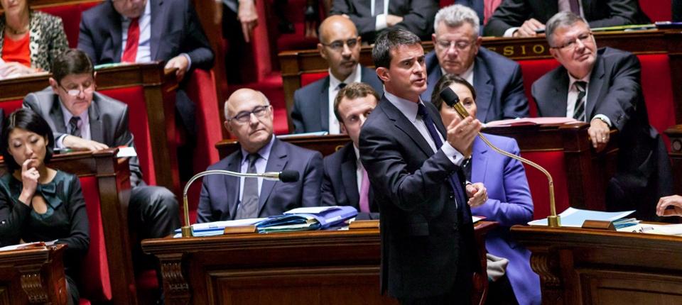 Photo du Premier ministre répondant le 8 octobre 2014 à des questions d'actualité à l'Assemblée nationale.