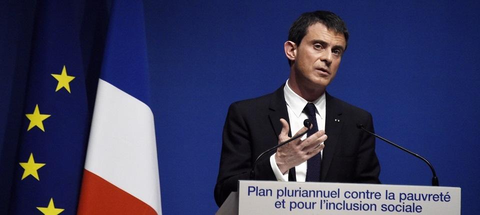 Photo de Manuel Valls présentant la feuille de route 2015-2017 du plan pluriannuel contre la pauvreté le 3 mars 2015.