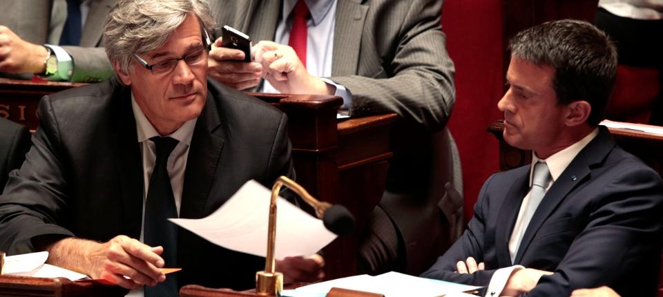 Photo de Manuel Valls et Stéphane Le Foll aux questions d'actualité à l'Assemblée le 22 juillet.