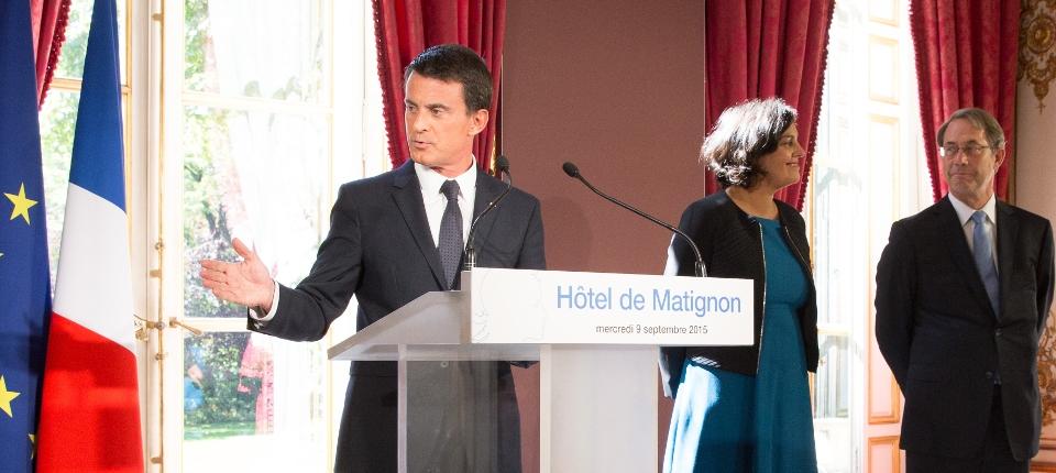 Photo de Manuel Valls à Matignon le 9 septembre 2015 avec Myriam El Khomri et Jean-Denis Combrexelle