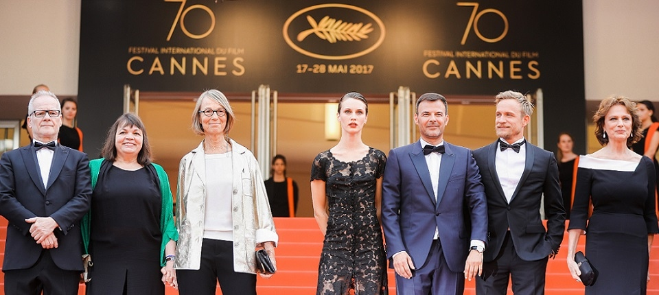 General Delegate of the Cannes Film Festival Thierry Fremaux (L) and French Culture Minister Francoise Nyssen (3rdL) greet (From 2ndL) French actress Myriam Boyer, French actress Marine Vacth, French director Francois Ozon, Belgian actor Jeremie Renier and British actress Jacqueline Bisset as they arrive on May 26, 2017 for the screening of the film 'L'Amant Double' (Amant Double) at the 70th edition of the Cannes Film Festival in Cannes, southern France.