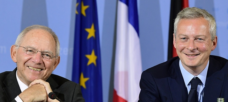 German Finance Minister Wolfgang Schaeuble (L) and the new French Economy minister Bruno le Maire give a press conference