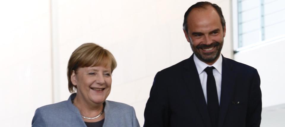 Angela Merkel and Edouard Philippe