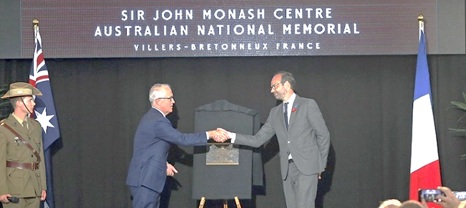 French Prime Minister Edouard Philippe (R) shakes hands with Australia's Prime Minister Malcolm Turnbull after the opening of the Sir John Monash Centre at Australian National Memorial on April 24, 2018 in Villers-Bretonneux