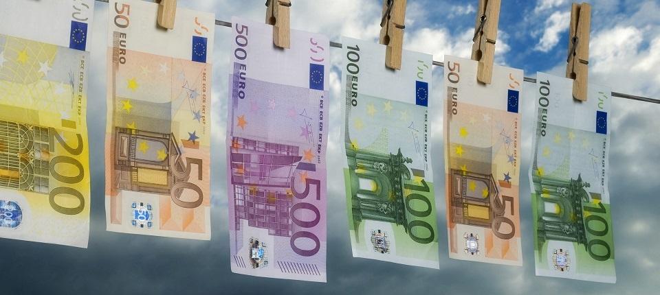 Euro bills hanging on a washing line, symbolizing money laundering.