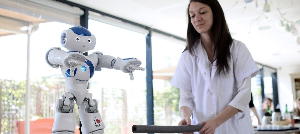 A researcher training Nao Robot in her laboratory